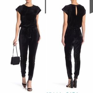 MATERIAL GIRL Velour Jumpsuit with Mesh Sleeves.